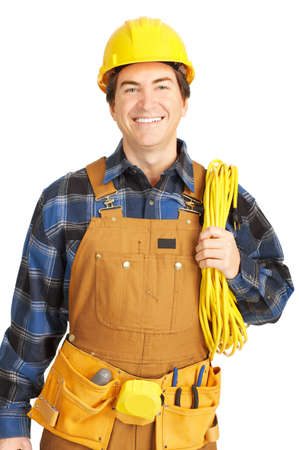 Handsome builder in yellow uniform. Isolated over white background  photo