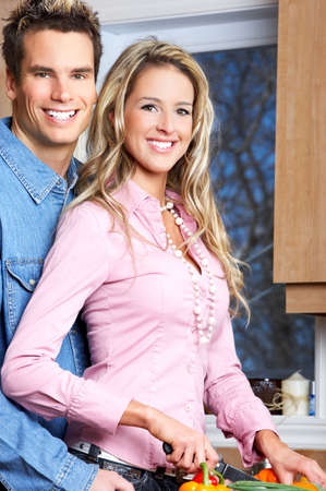 Young love couple cooking in the kitchen Stock Photo - 4752431