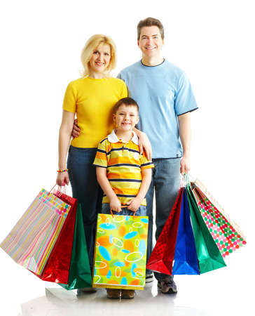 Happy family shopping. Father, mother and boy with plant. Stock Photo - 4780776