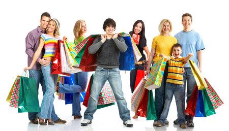 chicas comprando: Feliz la gente de compras. Aislado sobre fondo blanco Foto de archivo