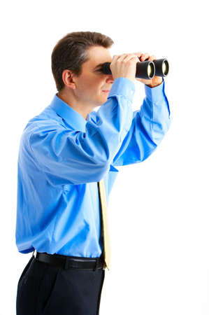 binocular: businessman  with binoculars looking to the future