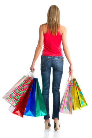 Shopping woman. Isolated over white background Stock Photo - 4808160