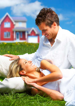 Young love couple smiling dreaming about a new home.  Real estate concept Stock Photo - 4808174