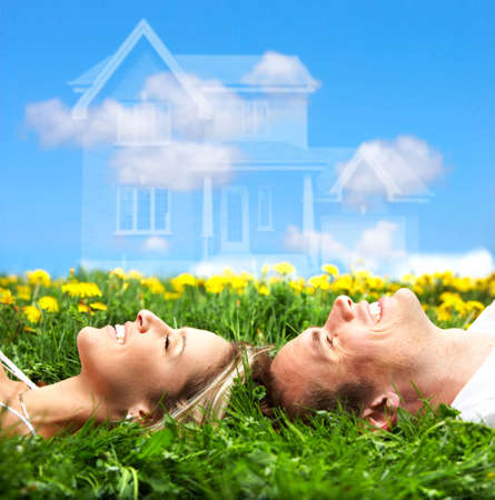 Young love couple smiling dreaming about a new home.  Real estate concept  Stock Photo