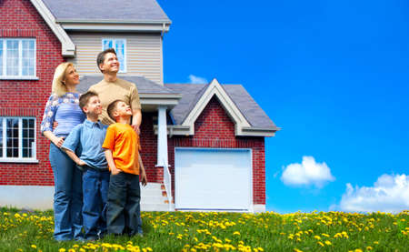 Young family dreaming about a new home.  Real estate concept  photo