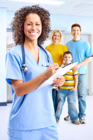 Smiling family medical doctor nurse and young family. Stock Photo - 4823392