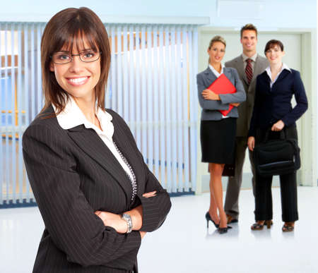 buisness: Buisness woman and young smiling business people.   Stock Photo