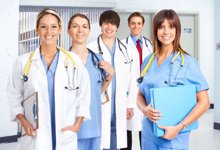 Smiling medical people with stethoscopes. Doctors and nurses Stock Photo - 4823399