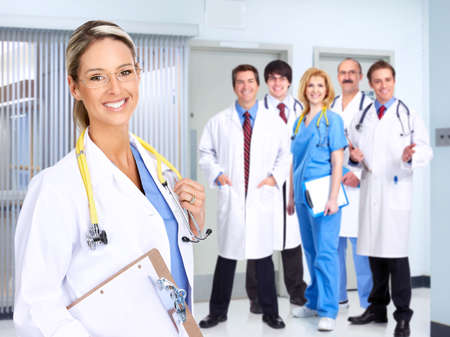 hospital background: Smiling medical people with stethoscopes. Doctors and nurses    Stock Photo