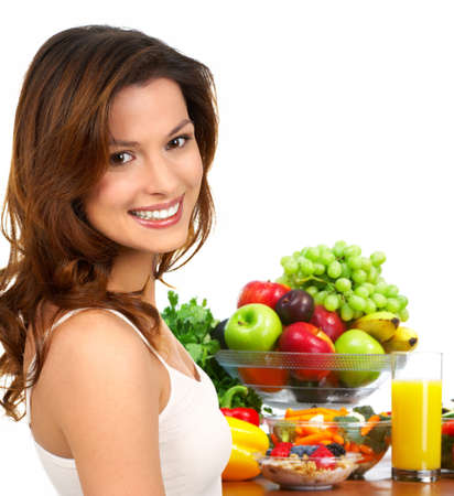 Young smiling woman  with fruits and vegetables. Over white background Stock Photo - 4823406