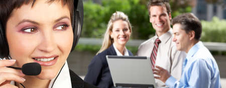 Beautiful  business woman with headset. Business people meeting   photo