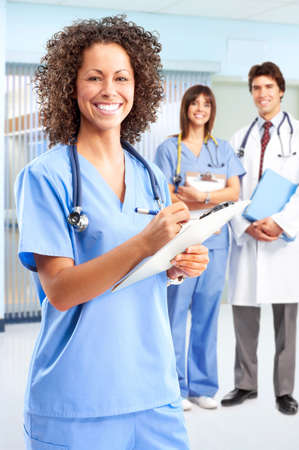 coworker: Smiling medical people with stethoscopes. Doctors and nurses   Stock Photo