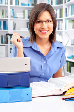 Pretty business woman working in the office Stock Photo - 4865108