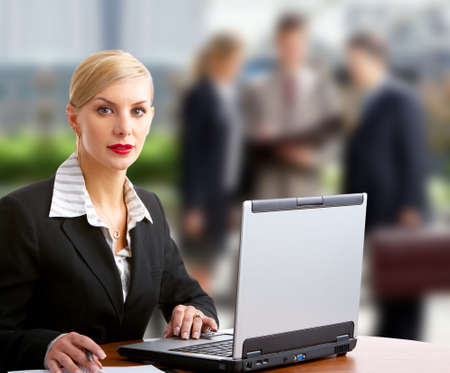 Business woman and business people working with laptop.   photo