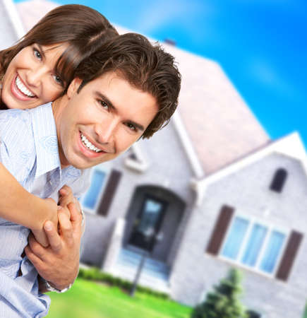 the apartment: Young love couple smiling dreaming about a new home.  Real estate concept