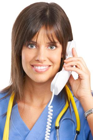 Smiling medical nurse with telephone. Isolated over white background Stock Photo - 4872517