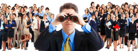 binoculars: businessman  with binoculars looking at the business people