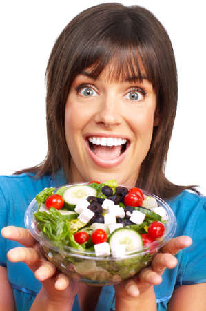 Young smiling woman  with fruits and vegetables. Over white background Stock Photo - 4903708