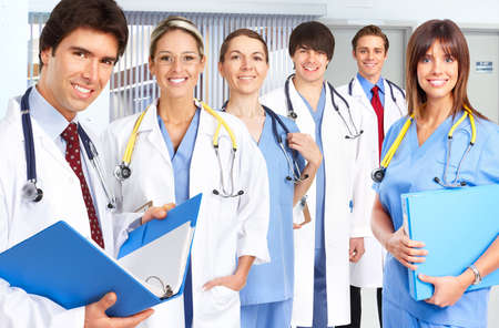 Smiling medical people with stethoscopes. Doctors and nurses Stock Photo - 4903827