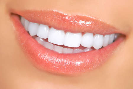 Beautiful young woman smile and teeth. Close up Stock Photo - 4913575