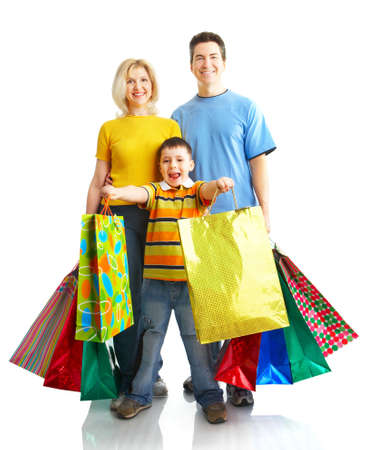 Happy family shopping. Isolated over white background  photo