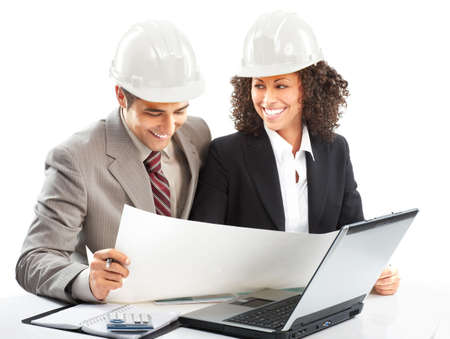 Working young architects. Isolated over white background Stock Photo - 4913753