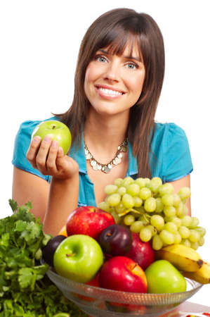 Young smiling woman  with juice, fruits and vegetables. Over white background Stock Photo - 4939444