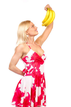 Beautiful young woman with bananas. Isolated over white background  photo