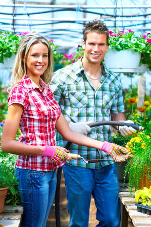 Young smiling people florists working in the garden Stock Photo - 4939668