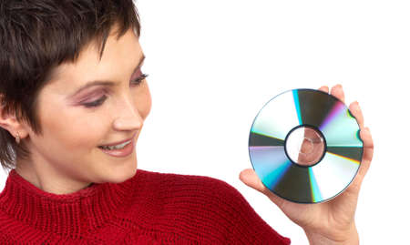 Young beautiful woman holding a cd. Isolated over white background  photo
