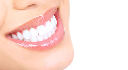 teeth whitening: Beautiful young woman teeth. Isolated over  white background