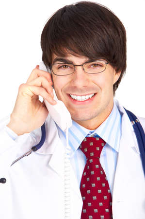 Smiling medical doctor calling by phone. Over white background Stock Photo - 4943176
