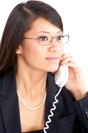 Young smiling business woman calling by  phone. Over white background Stock Photo - 4943172