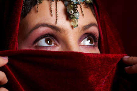 Mysterious eastern woman with beautiful eyes.  photo