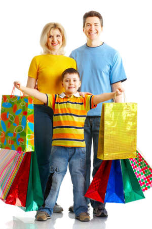 Happy family shopping. Isolated over white background  Stock Photo