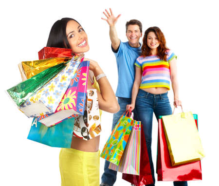 Happy shopping people. Isolated over white background  photo