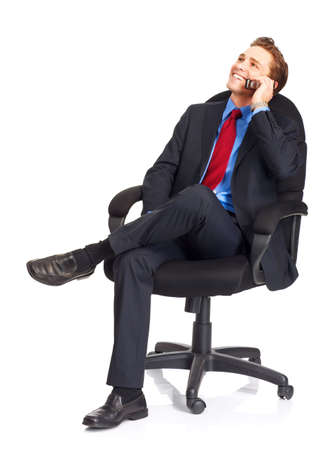 young businessman calling by cellular phone.  photo