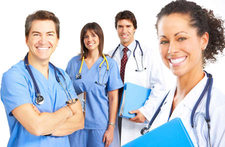 Smiling medical people with stethoscopes. Doctors and nurses over white background  photo
