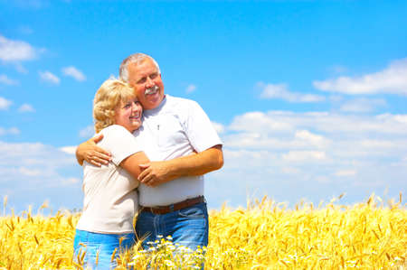 Smiling happy elderly couple outdoor