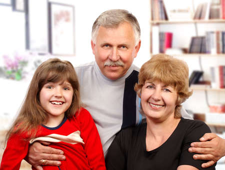 granny and grandad: Happy family. Father, mother and daughter at home