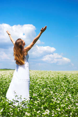 Beautiful young happy woman under blue sky. Stock Photo - 5002267