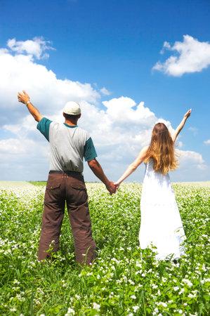 Young love couple smiling under blue sky  Banco de Imagens