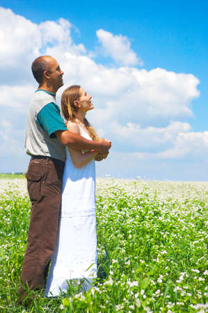 medical field: Young love couple smiling under blue sky  Stock Photo