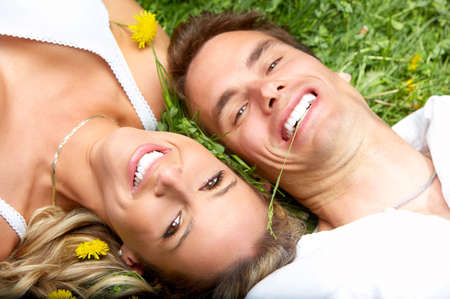 Young love couple on the green grass