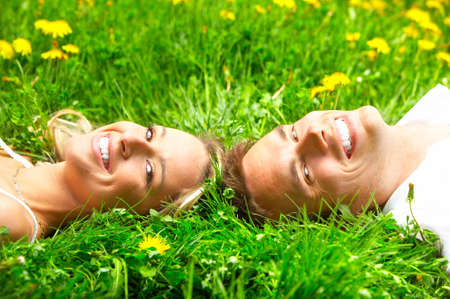 Young love couple on the green grass  photo