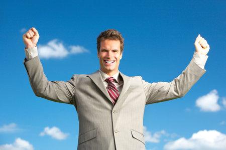 Successful happy businessman under blue sky.   photo