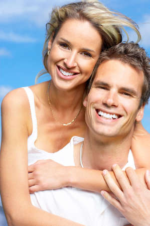 couples hug: Young love couple smiling under blue sky  Stock Photo