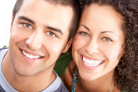 a tooth are beautiful: Happy smiling couple in love. Over white background