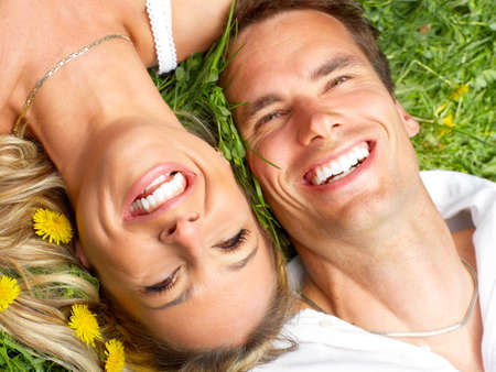 Young love couple on the green grass Stock Photo - 5068967