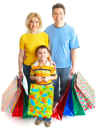 Happy family shopping. Isolated over white background Stock Photo - 5068982